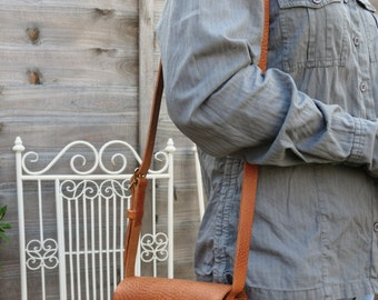Leather shoulder bag, hand-stitched, with horse's head motif