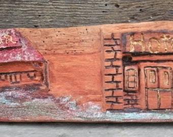 Main Street Essentials, a Carving in Sugar Pine