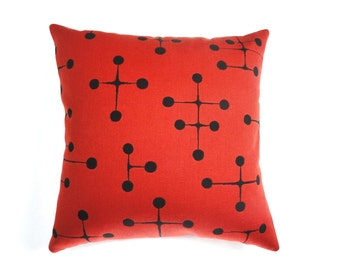 """Large Dots pattern by Charles and Ray Eames - Maharam Fabric. 17"""" x 17"""" pillow with feather insert. Red / Black"""
