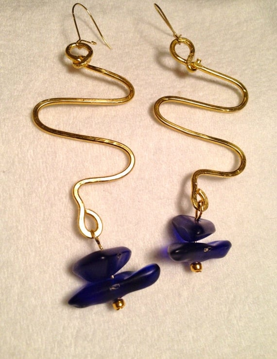 Brass earrings with flattened wire work and dark blue asymmetric glass beads