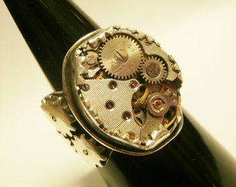 Steampunk watch mechanism ring. Moving cogs on side. Sterling silver.