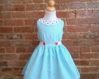 Girls Boutique dress Spring, Summer, Jumper, Easter, Party, classic style. Lace detailing with front button tabs and back bow. Sizes2T-12