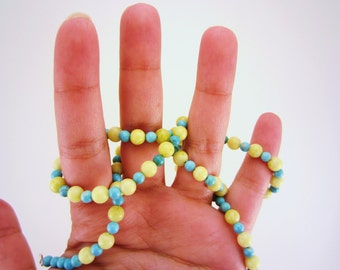 PRICE CUT. Lemon yellow and pale blue beaded necklace. Long necklace. Sunny sky colored. Silver toned clasp. Great for layering.