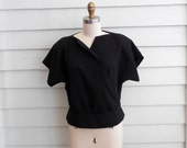 1980s black peplum blouse from Caron Chicago / Medium to Large asymmetrical button up shirt / cropped avant garde wrap blouse