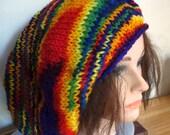 Slouchy reggae beanie hand knit in rainbow acrylic yarn