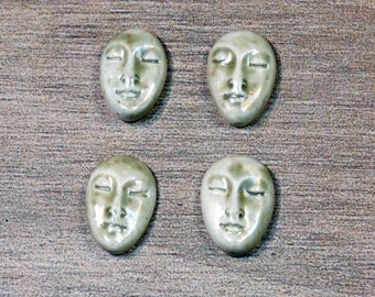 Set of Four Small Almond Ceramic Face Stone Cabochons in Pale Flesh