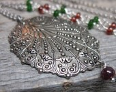 Winter Solstice necklace ... antiqued silver filigree with ruby, red spinel, and chrome tourmaline