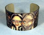 Creepy big metal cuff bracelet from Jasmine Becket-Griffith Art divine hand speak no evil horror