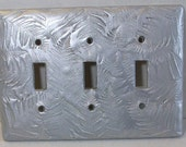 Silver Ferns triple toggle light switch cover