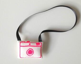 camera hanger neon pink