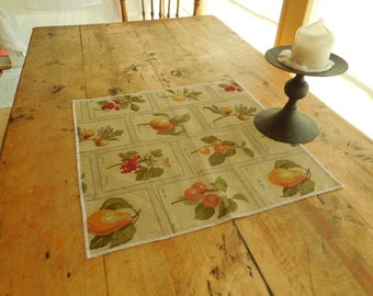 Linen Placemat In Shades of Beige, Orange and Green With a Fruit Pattern
