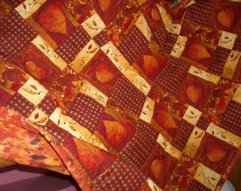 Fall/Autumn Quilted Leaves Table Topper in rusts, browns, cream, oranges, black, golds