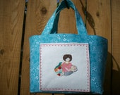 Cozy Stitching Lady on Pocket of Turquoise Blue with White Dot Floral Mini Tote