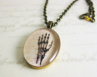 "Vintage Inspired Skeletal Hand Anatomical Illustration - Resin Oval Pendant necklace - 19"" bronze chain with matching clasps"