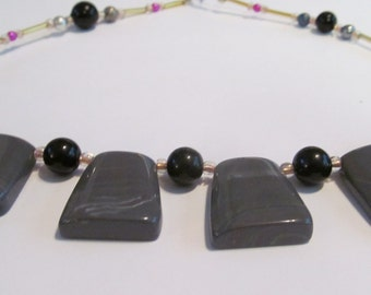 gray bib necklace