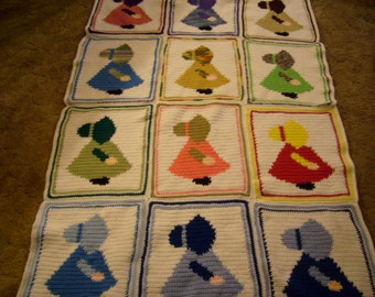 an afghan approx 40 x 63 with sunbonnet sue images on both sides