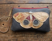 golden io moth on crackly black repurposed leather mini clutch