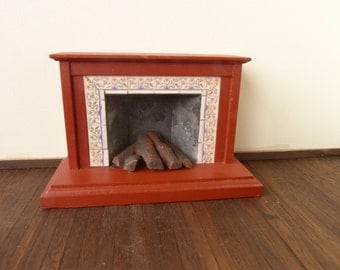 vintage dollhouse  plastic fireplace in a red brick color and light under the logs  made by EPOCH CO. LTD. 1985