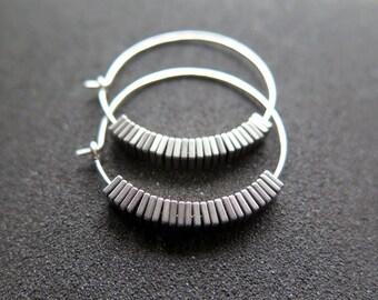 sterling silver hoop earrings. hematite jewelry. geometric hoops.