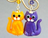 Yellow and purple cat earrings, animal earrings, lampwork glass, mismatched cats, purple and yellow cat, Tanzanite Swarovski crystal