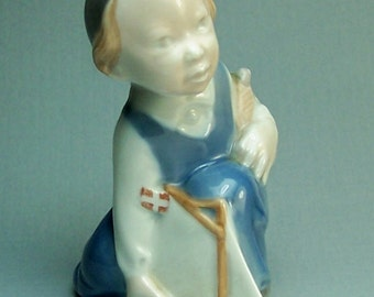 Vintage Porcelain Figurine of a Seated Boy with Sailboat by Royal Copenhagen