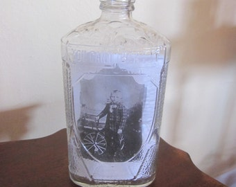 Little Boy and Bike Vintage Photo In Old Bottle