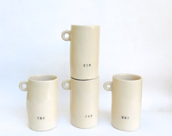 4 hand built porcelain cups