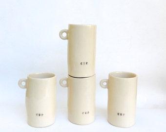 hand built porcelain cup   ...   take a sip