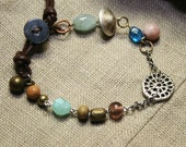 sequence sung to one  :  beaded chain artisan wrap bracelet