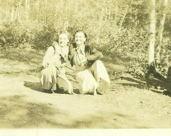 Friends 1940s Women in Pants WW2 Era Kneeling Outside Woods Trees Vintage Black White Photo Photograph