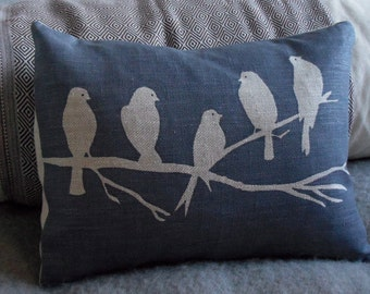 Hand printed midnight blues bird on a branch cushion
