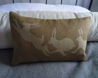 hand printed natural triptyque hare cushion cover