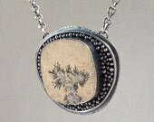 sterling silver pendant necklace with dendrites on limestone