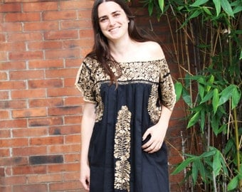 Black hand embroidered gold   and antique gold  Mexican Wedding Dress