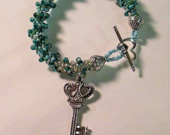 CLEARANCE PRICED - Turquoise, Green, and Teal Spiral Beaded Charm Bracelet 7 inch