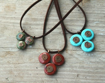 Triangle transformer funky kinetic pendant with three spirals.