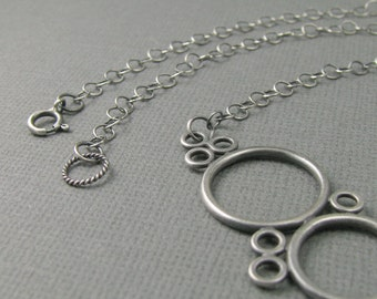 solid .925 sterling silver rings necklace. many circles. round hoop necklace. sterling silver circle choker