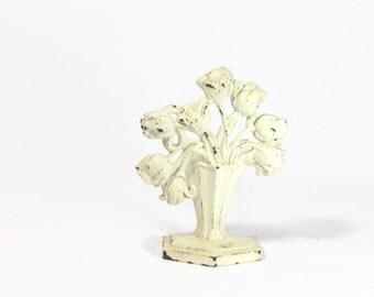 Vintage cast iron door stop tulips in vase chippy white paint