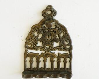 A vintage solid brass chanukah menorah