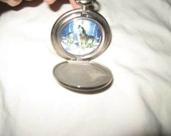 """vintage Franklin Mint  collector  CALL OF THE North """" timber wolf  pocket watch with original leather pouch"""