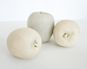 Three earthenware apples. Sculpture, life size, pastel, light, natural, neutral, rustic, hand made.