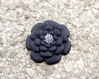 Black leather flower brooch