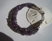 Bracelet, soft, hand knit, purple thread, pearls, glass beads, silver clasp, lame thread, purple beads, glass beads, silver filigree cones