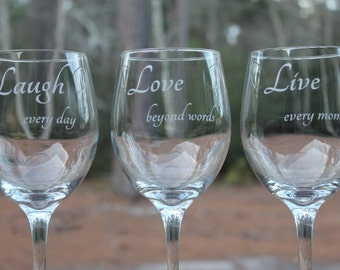 3 Wine glasses with Live, Laugh, Love engraved on glasses