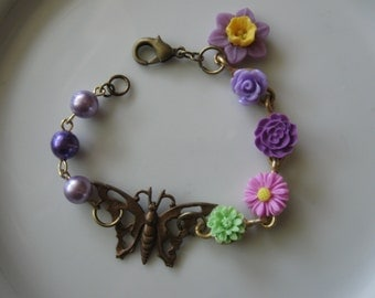 Flowers and Butterfly.vintage and flower assemblage bracelet