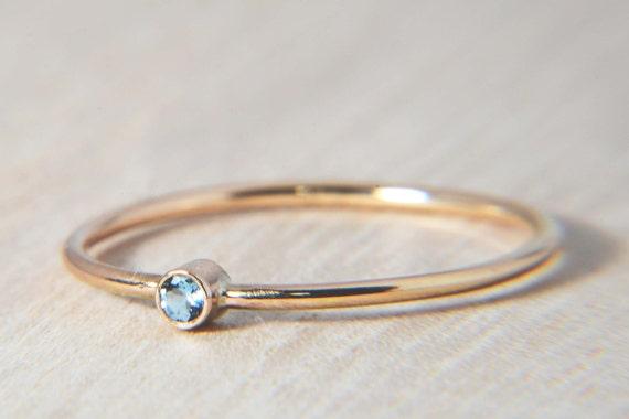 simple aquamarine ring in 14k gold march birthstone