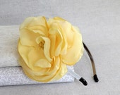 Thin Grey Headband with a Single Flower in Pale Yellow