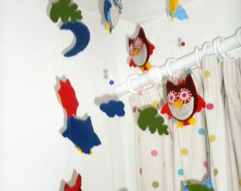 Owl nursery mobile including sun, moon and stars.  Hand-stitched in felt.