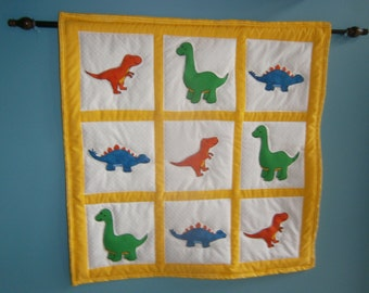 Dinosaur quilted and appliqued' wall hanging
