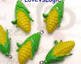 4 Corn Lucite Charms.